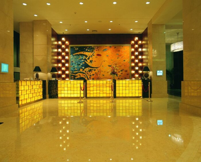 luxury_5_star_hotel_lobby_marble_reception_desk_wooden_metal_frame